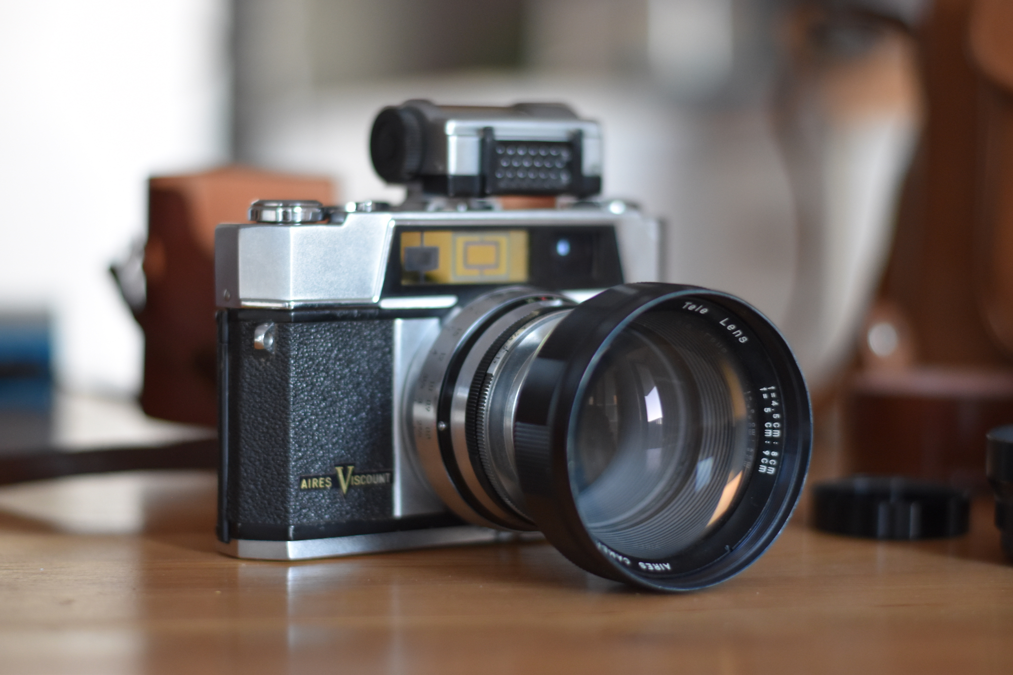 Viscount camera with selenium light meter and telephoto lens attachements.